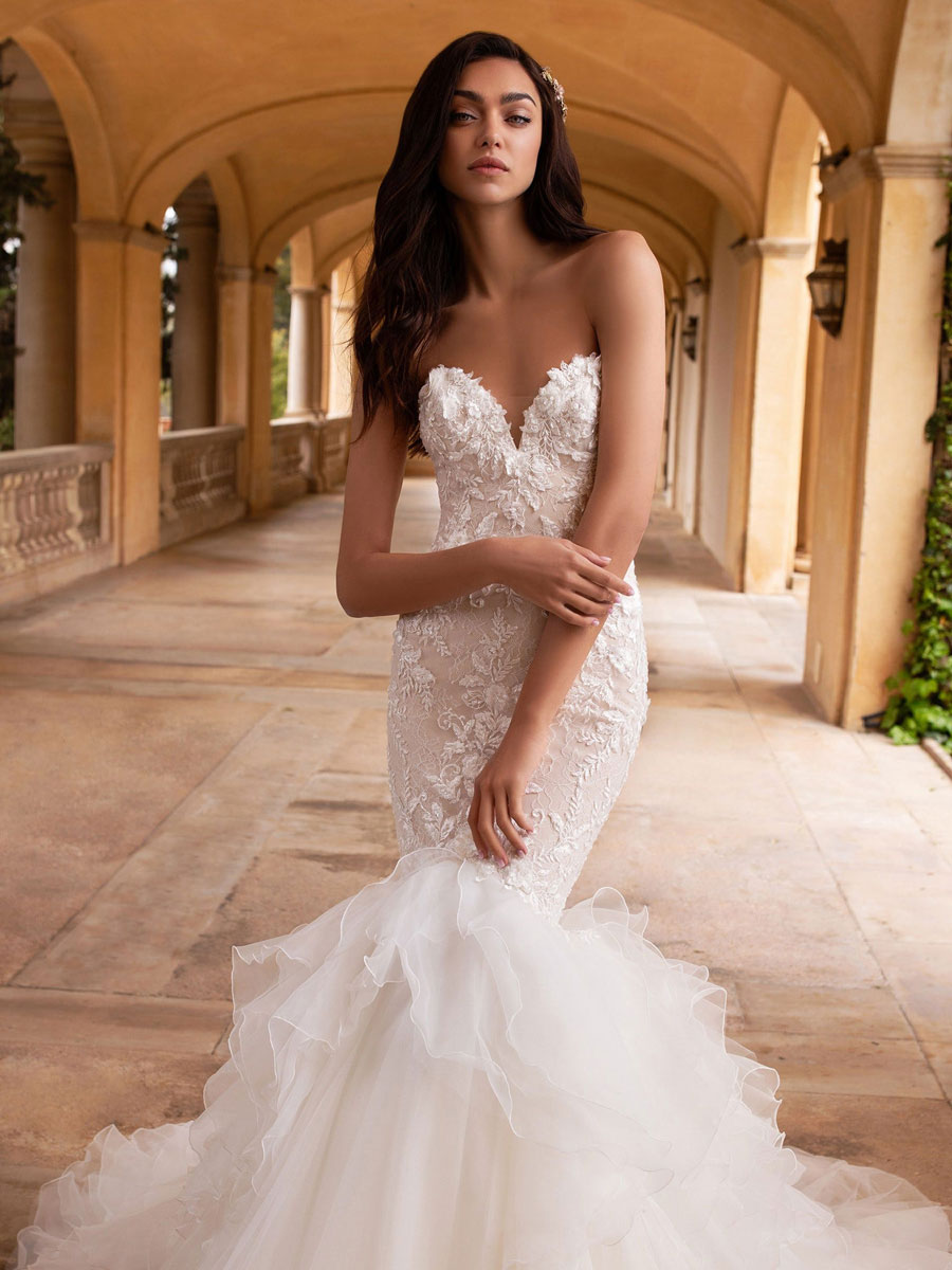 Mermaid dress with open back along with beaded appliques and a sweetheart neckline