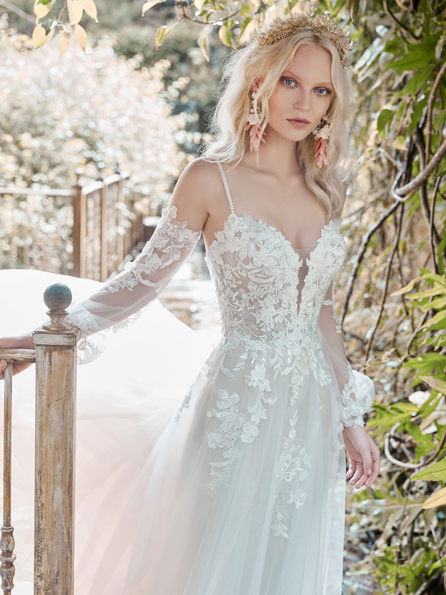 Cold-shoulder princess wedding dress with chic bishop sleeves.