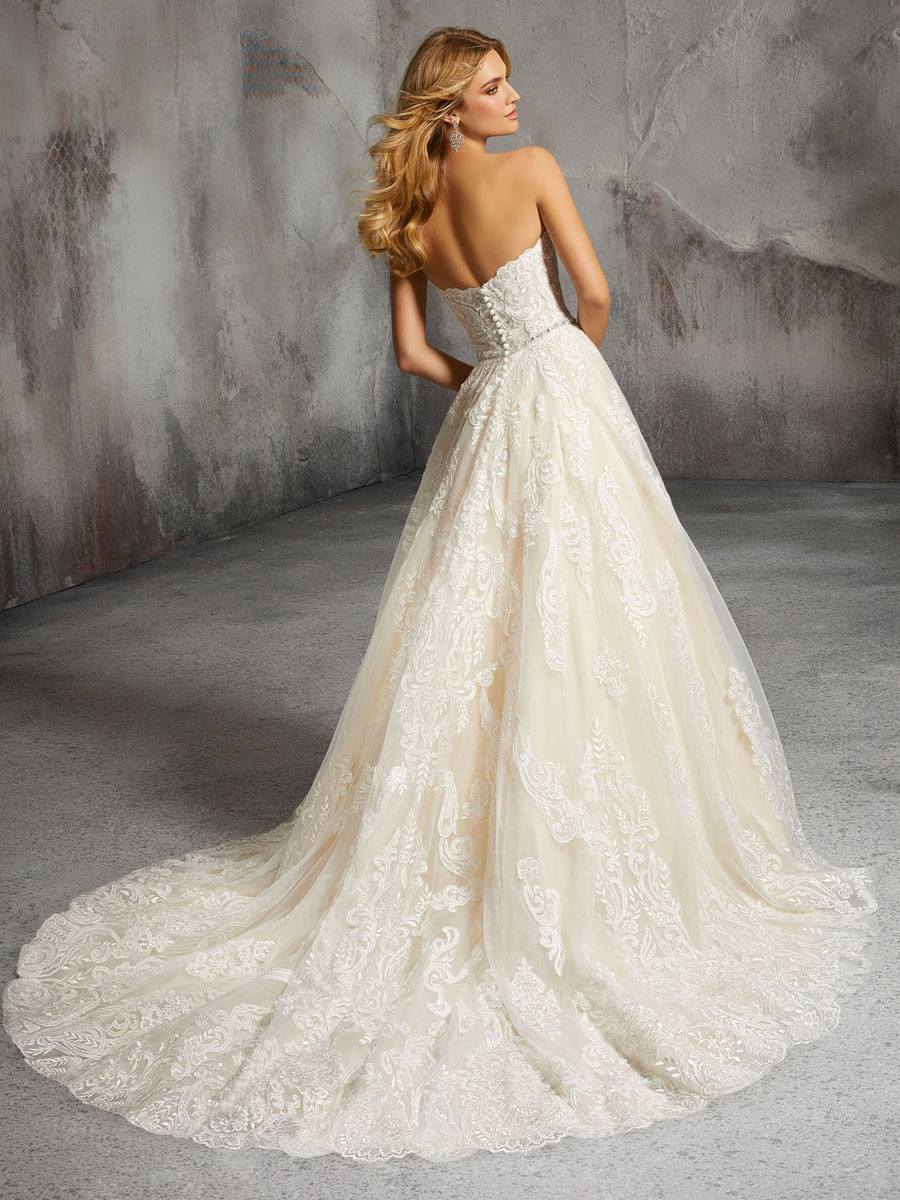 Elegant tulle wedding gown with a full A-line skirt.