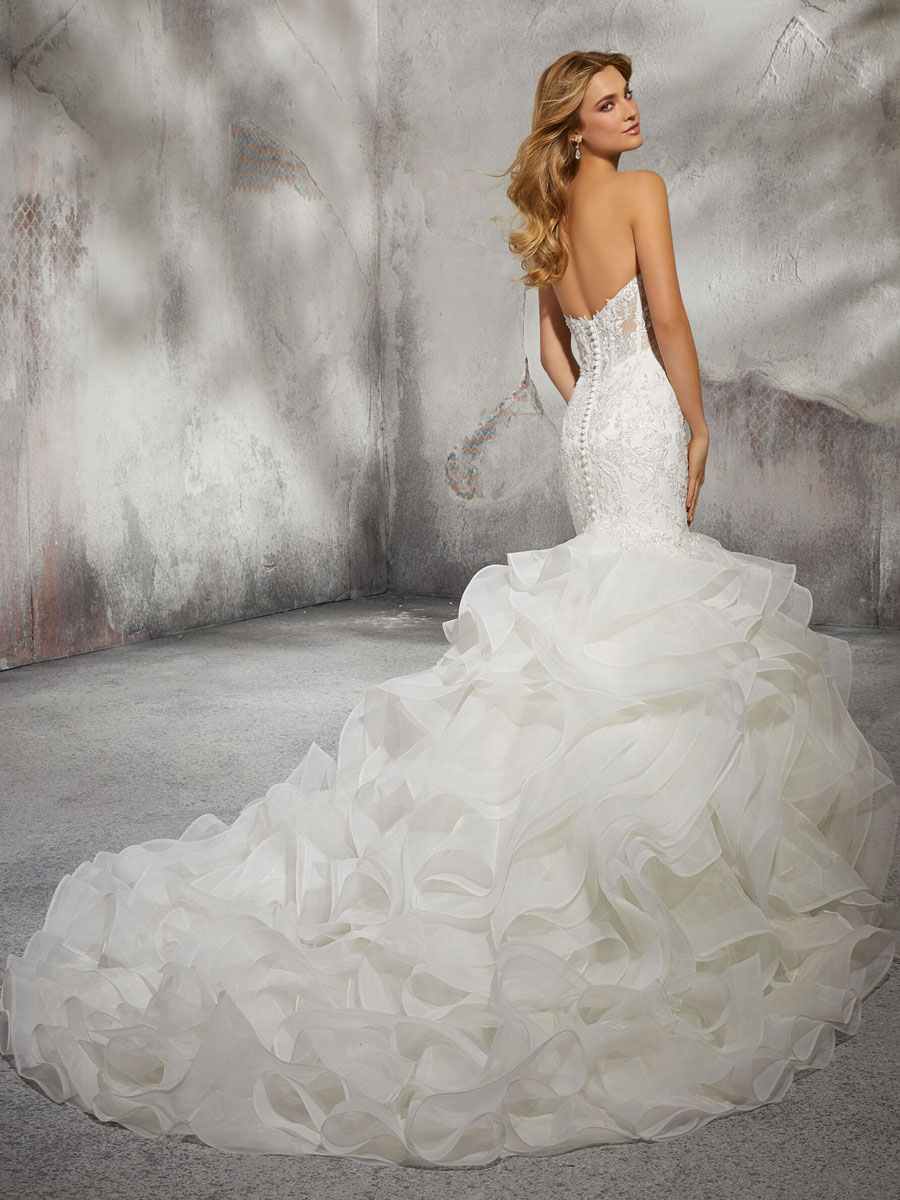 mermaid wedding dress with embroidered appliqués on the fitted bodice and covered back button