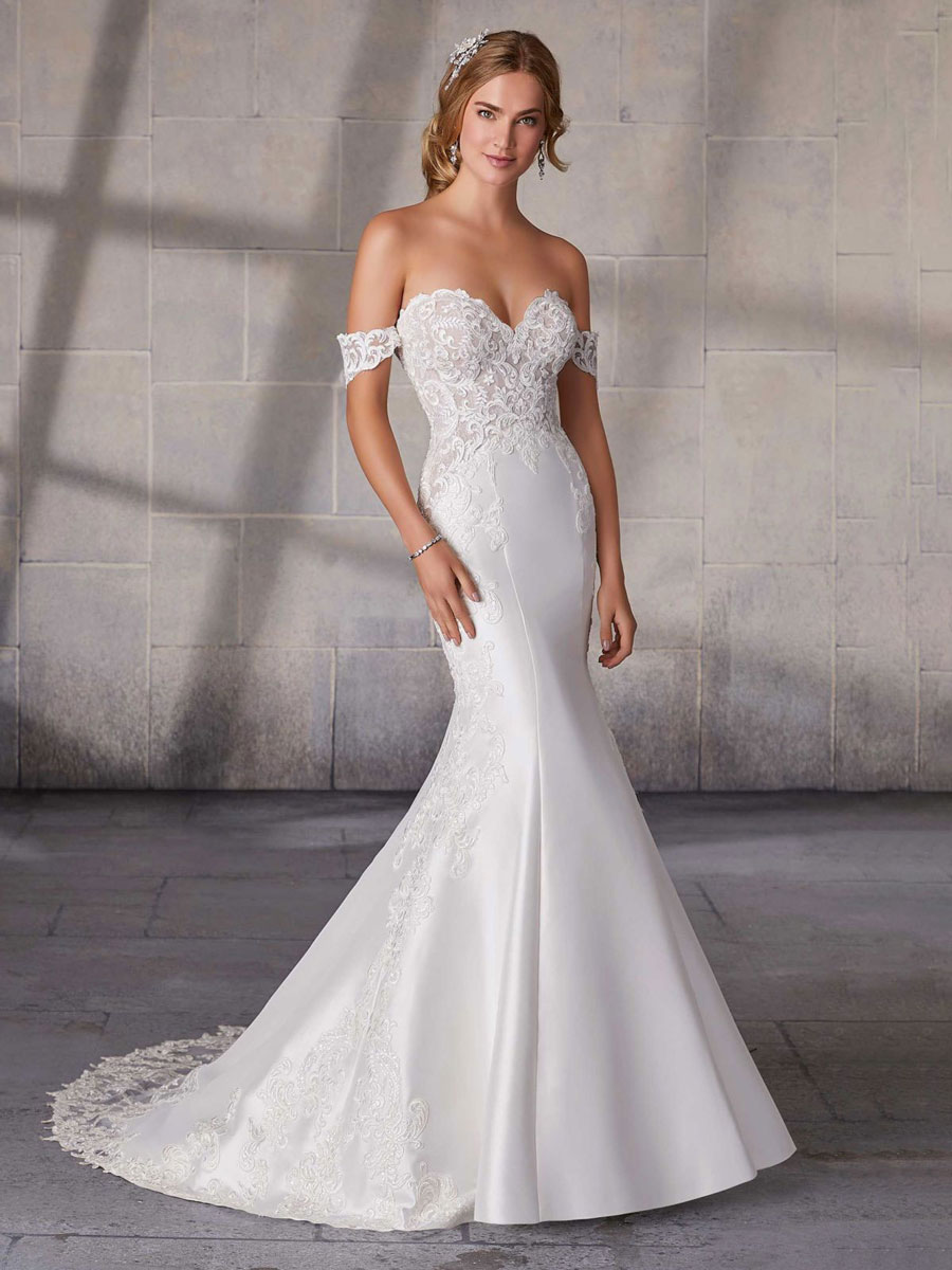 Fit to flare wedding gown with sweetheart bodice and detachable sleeves