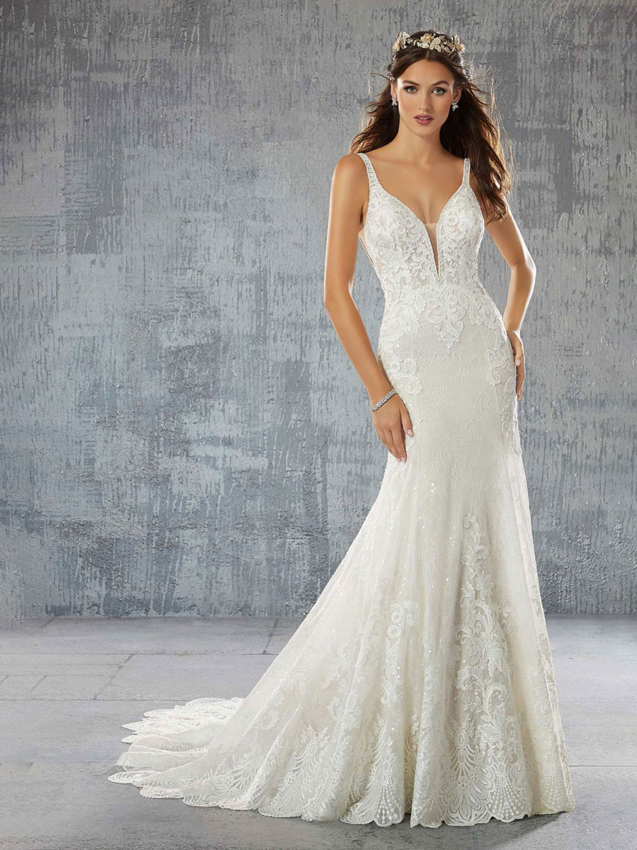Classic fit to flare designer wedding dress with strapped crisscross back.