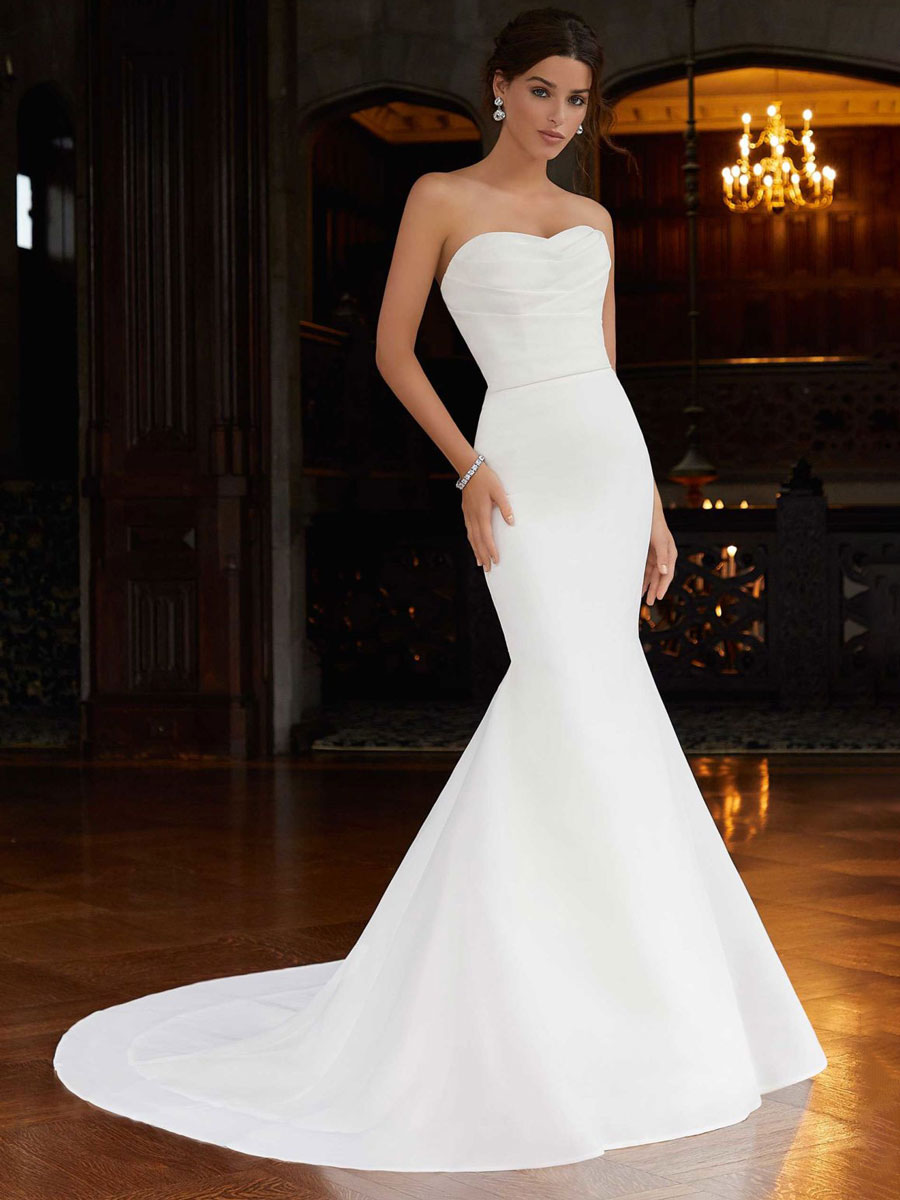 Glamorous mermaid wedding dress with a fit to flare, draped bodice.