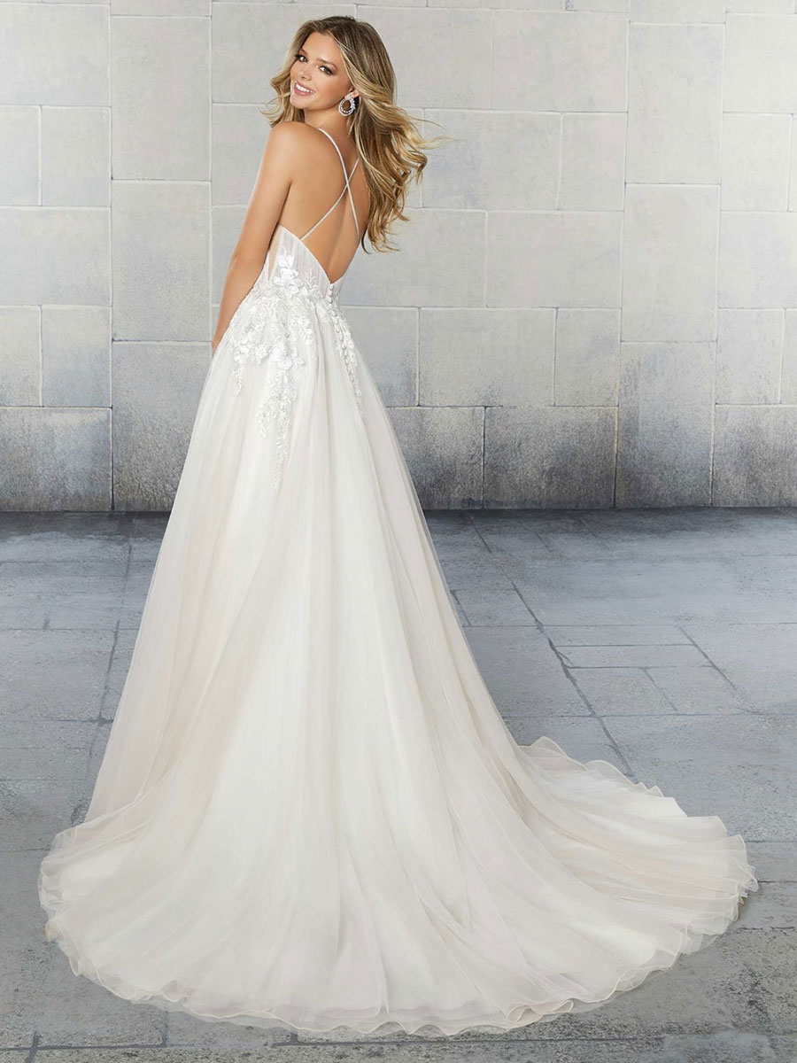 Wedding dress with draped net bodice, beaded with crystals and pearls.