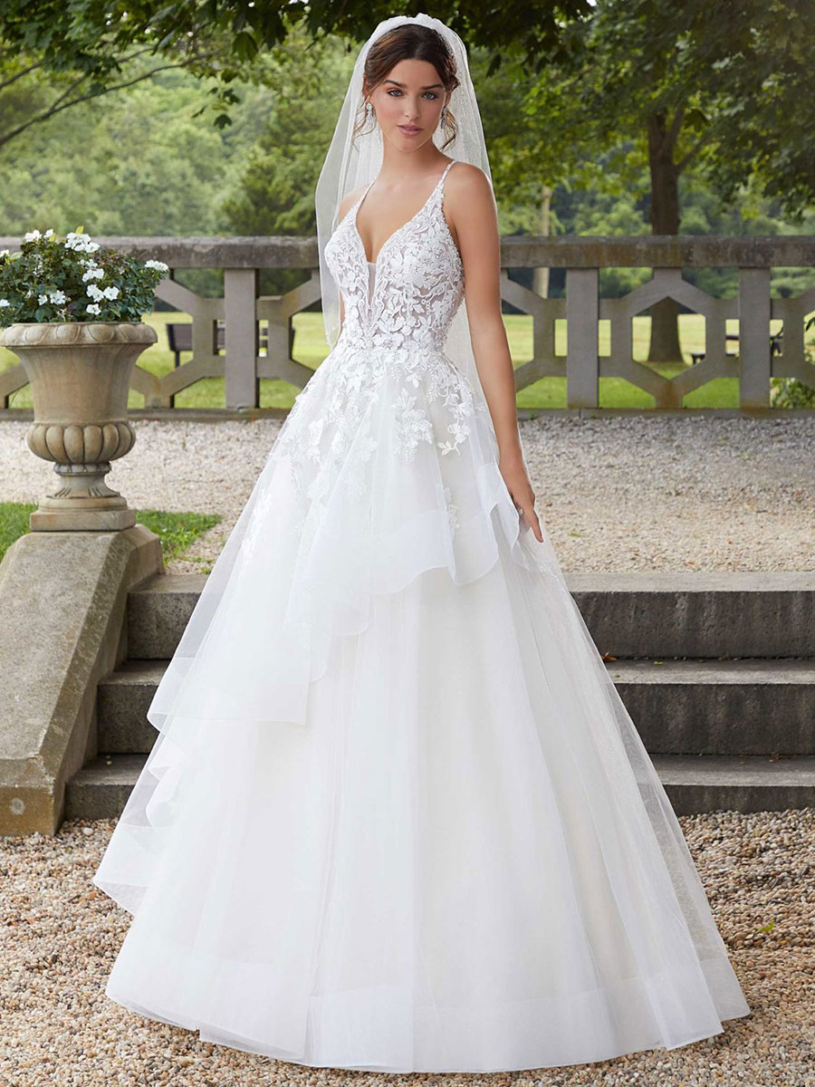 Tulle ball gown with horsehair edging and flounced skirt overlay.