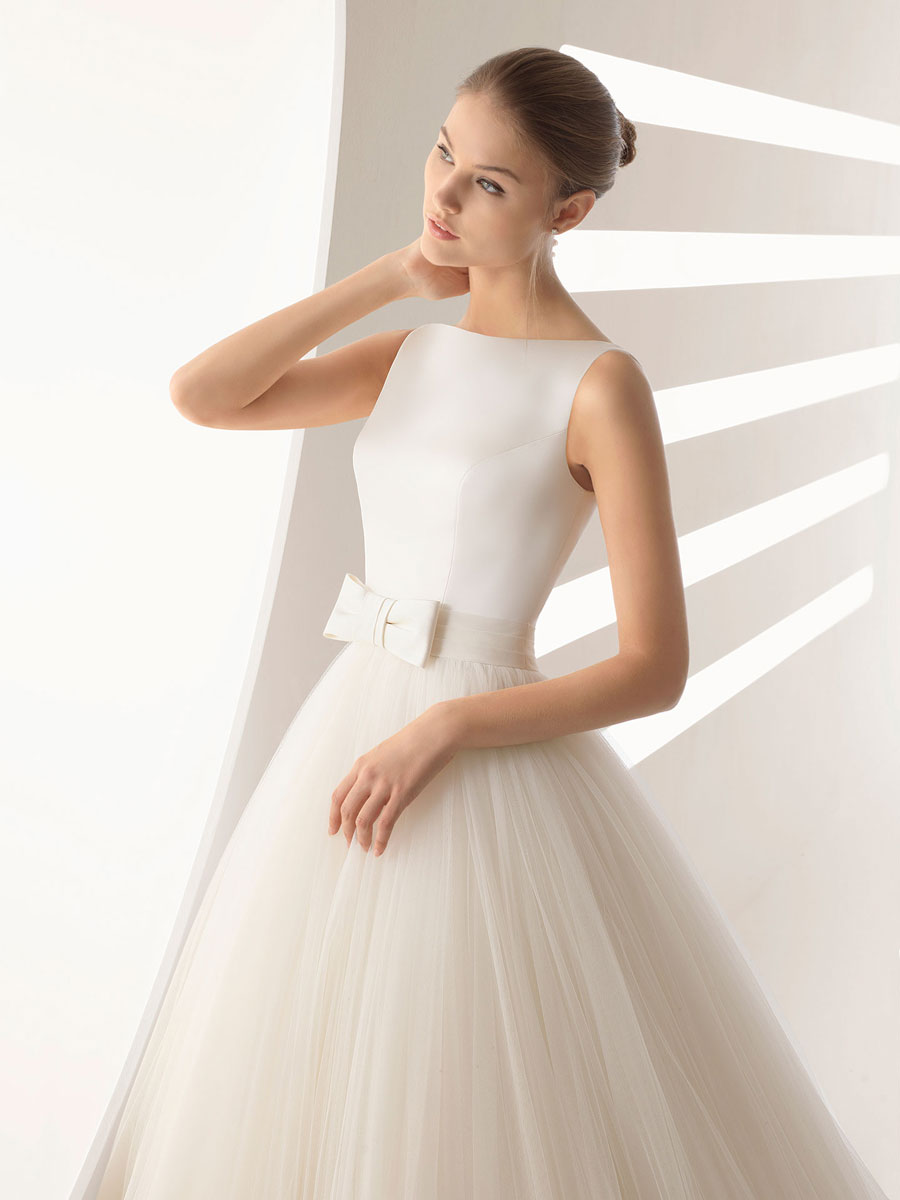 A beautiful soft satin bodice with a low open back along with satin and tulle