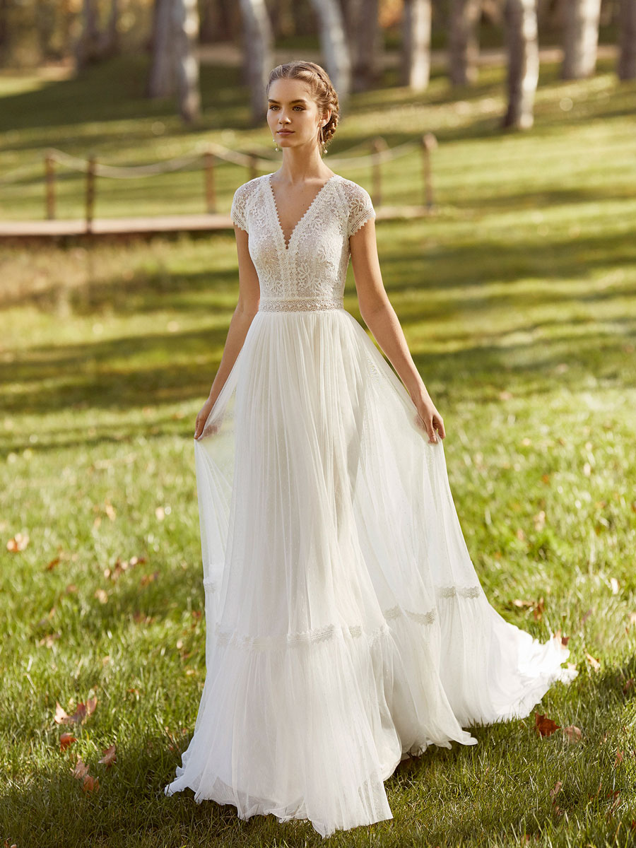 Elegant bridal gown with V-neckline and drop sleeves.